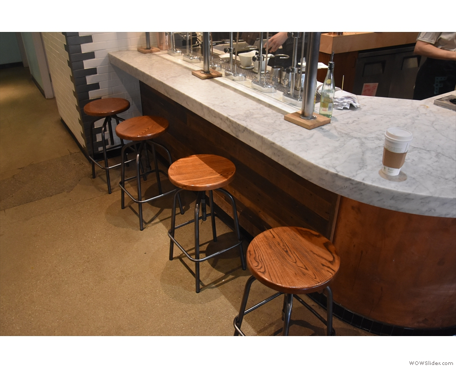 There's more seating back here, with a row of four bar stools at the end of the counter...