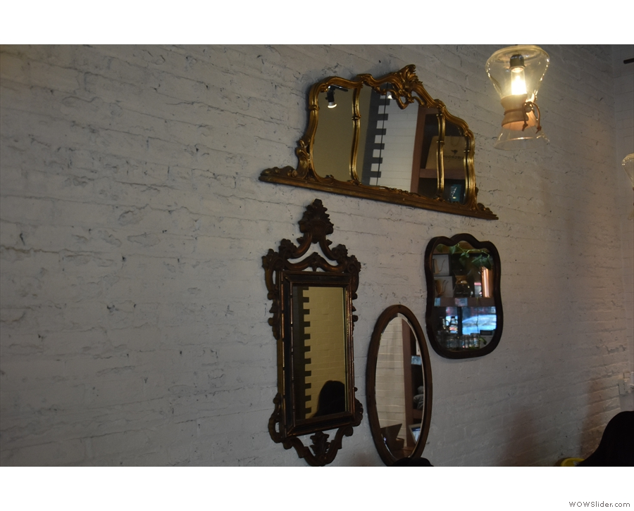 ... where you'll also find a bunch of mirrors hanging over the communal table.
