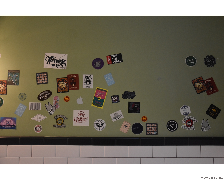 ... with the walls plastered with stickers from various roasters around America.