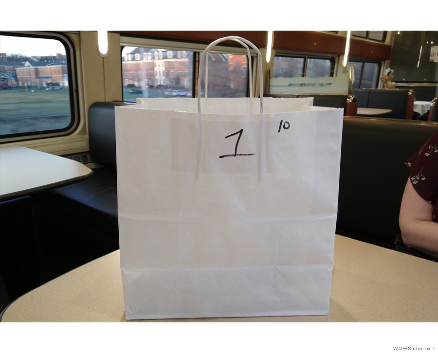 Instead of table service, our dinner came in a big white bag with our number on it.