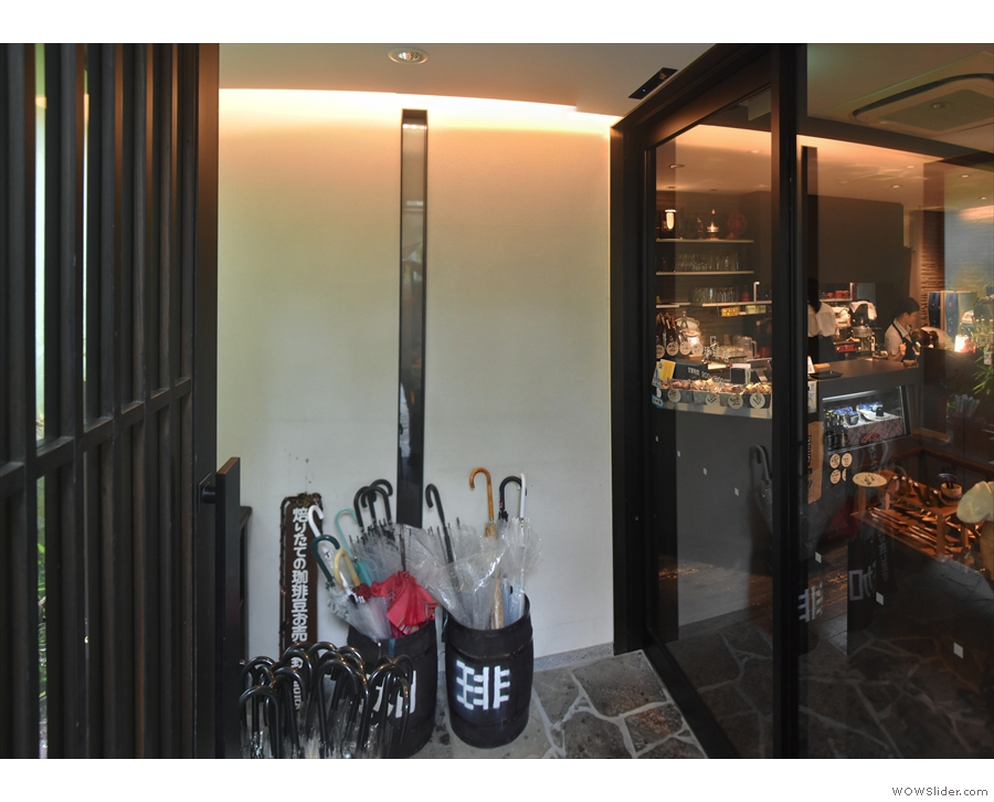 The entrance to the coffee shop proper is via a sliding glass door on the right, which...