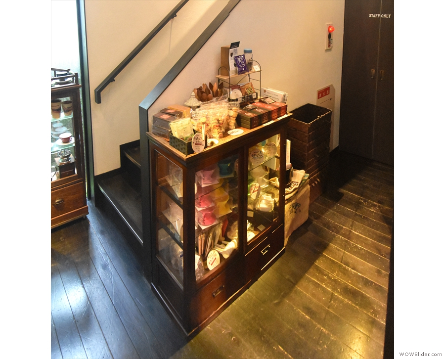 There's a neat display case full of retail items by the side of the stairs...