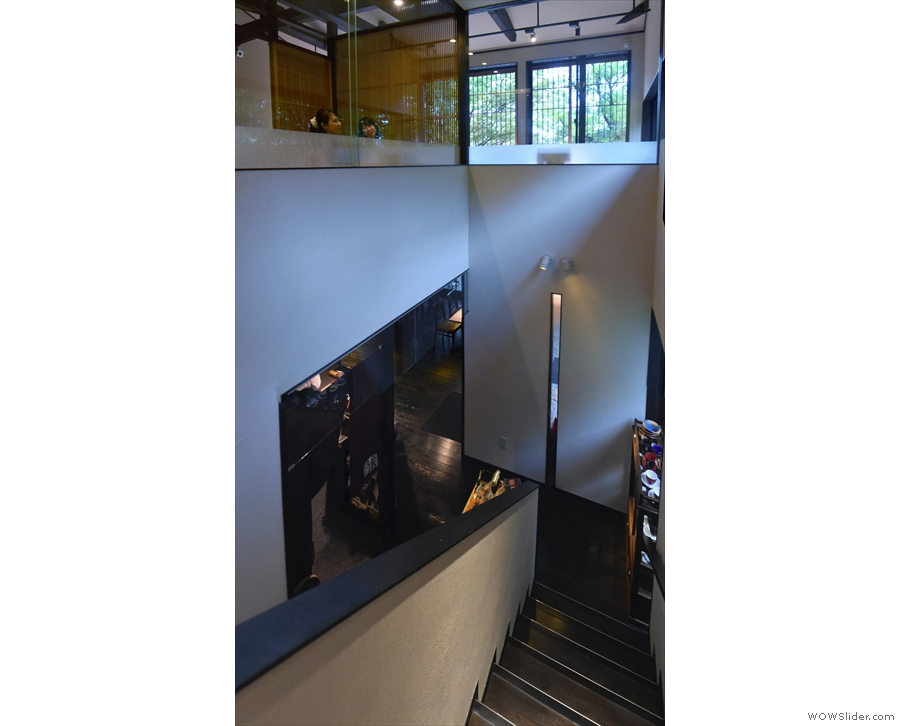The view from the top of the stairs where you can see the L-shaped upstairs seating area.