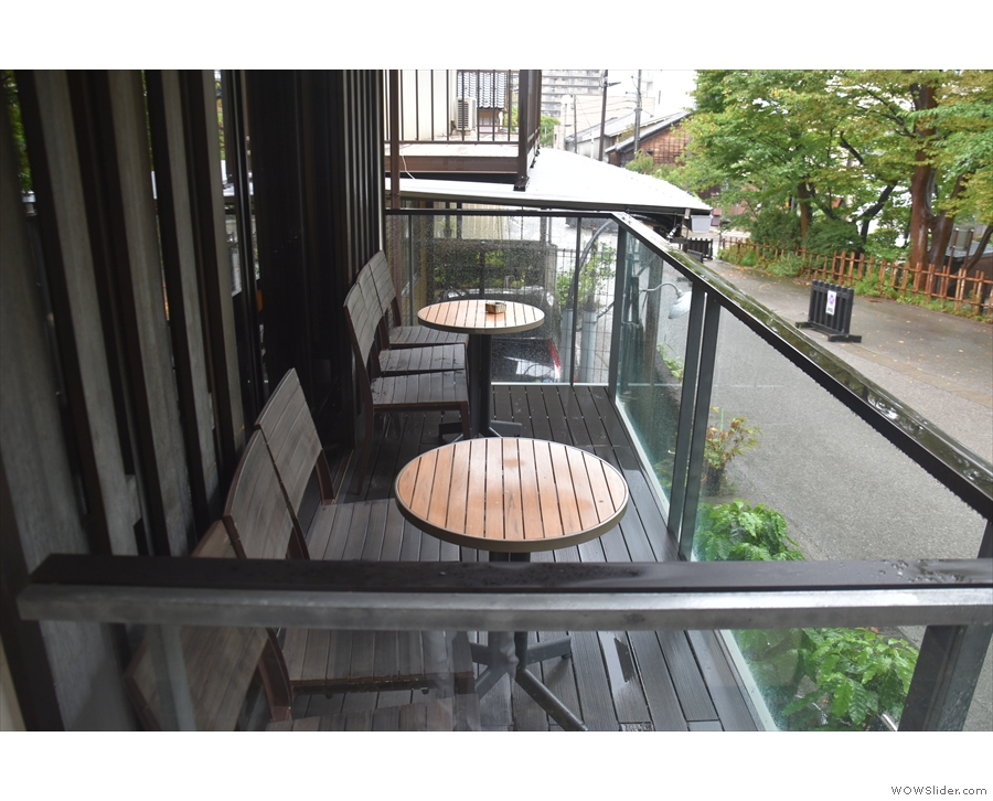 ... which lead out onto the enclosed terrace we saw from outside. There are two tables...