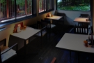 The remaining tables run along the front of the coffee shop...