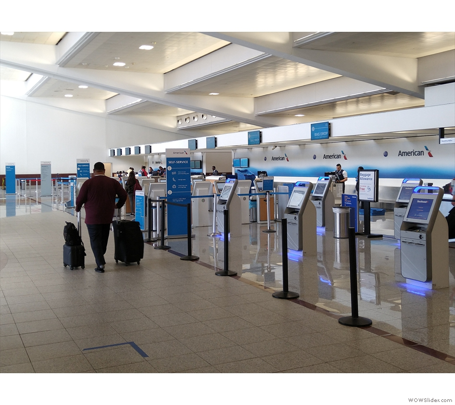 The American check-in area is at the far end of the terminal and was nice and quiet.