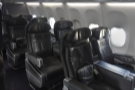 I was in the first class section at the front, which consisted of four rows of seats...