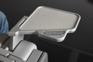 ... little drinks tray folds out from the front of the armest. Neat!