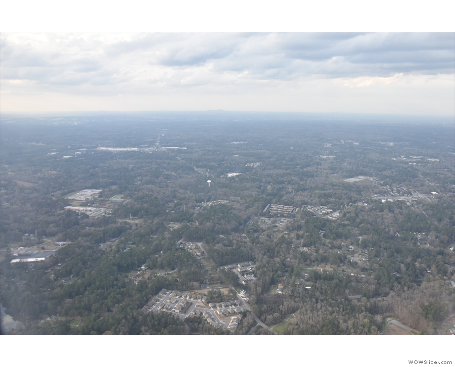 We quickly gain height as we fly west of the airport...