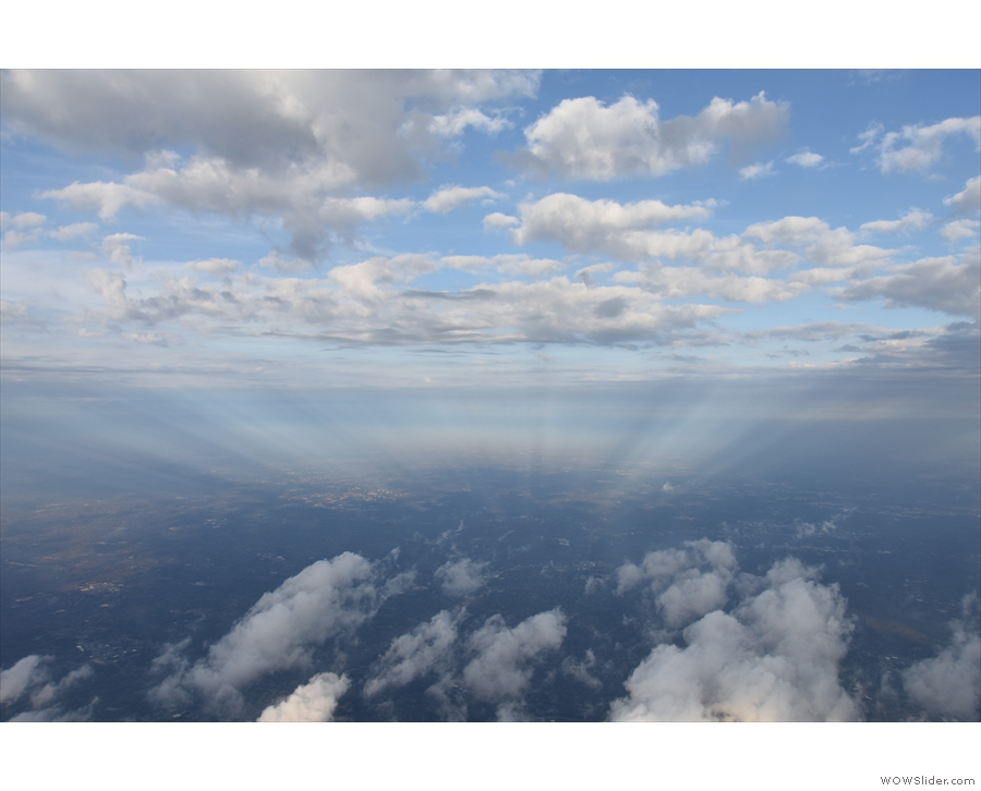 Just then, everything aligns and there's a magnificent display of light and cloud.