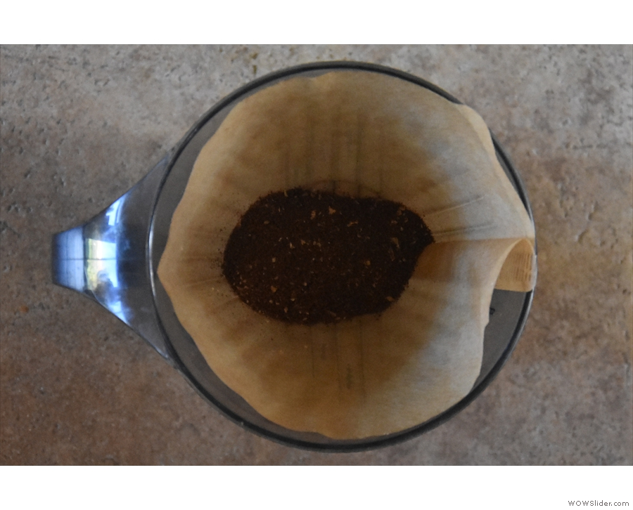 Grind your coffee, putting it into the rinsed filter paper. I use 18g with a medium grind.