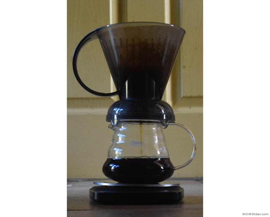 ... on the mug/carafe opens the valve at the bottom and the coffee filters through.