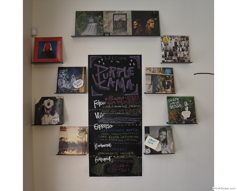 There are more records on the wall (surrounding the choices of beans) by the door.