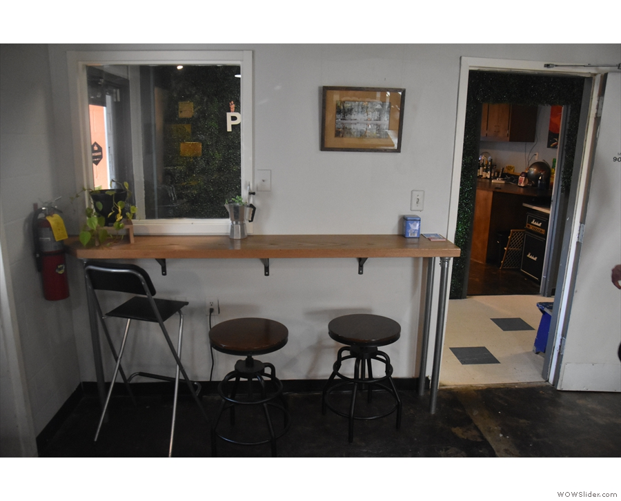 ... while to the right of the door is a three-person bar.