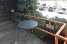 ... go out to a small patio with a solitary table.