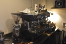 The espresso machine is behind the counter on the left-hand side...