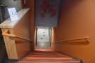 ... front of Strongbox West, head inside and go to this flight of stairs at the back...