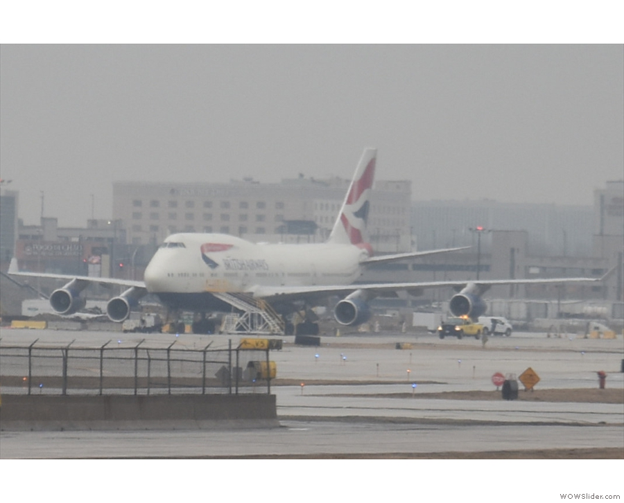 There's a British Airways Boeing 747 parked out on the tarmac.