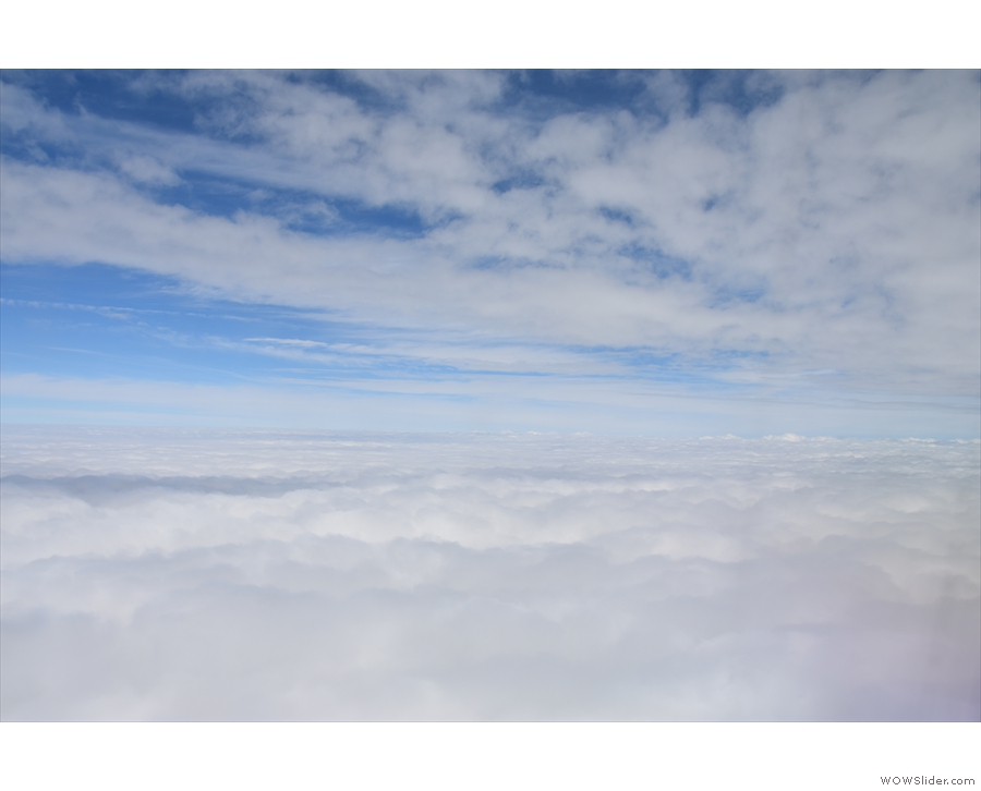 We broke through the top of the clouds five minutes after take-off.