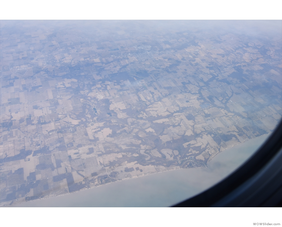 The patchwork of fields continues as we fly east, roughly following the coast.