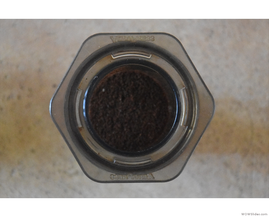 First, put the ground coffee into the inverted AeroPress...