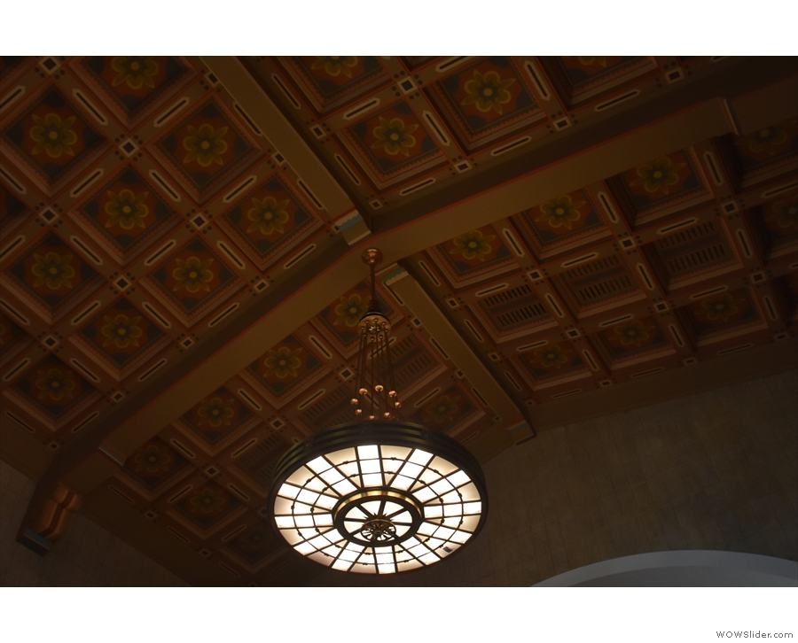 Check out the awesome light-fitting and the amazing wood-panelled ceiling.