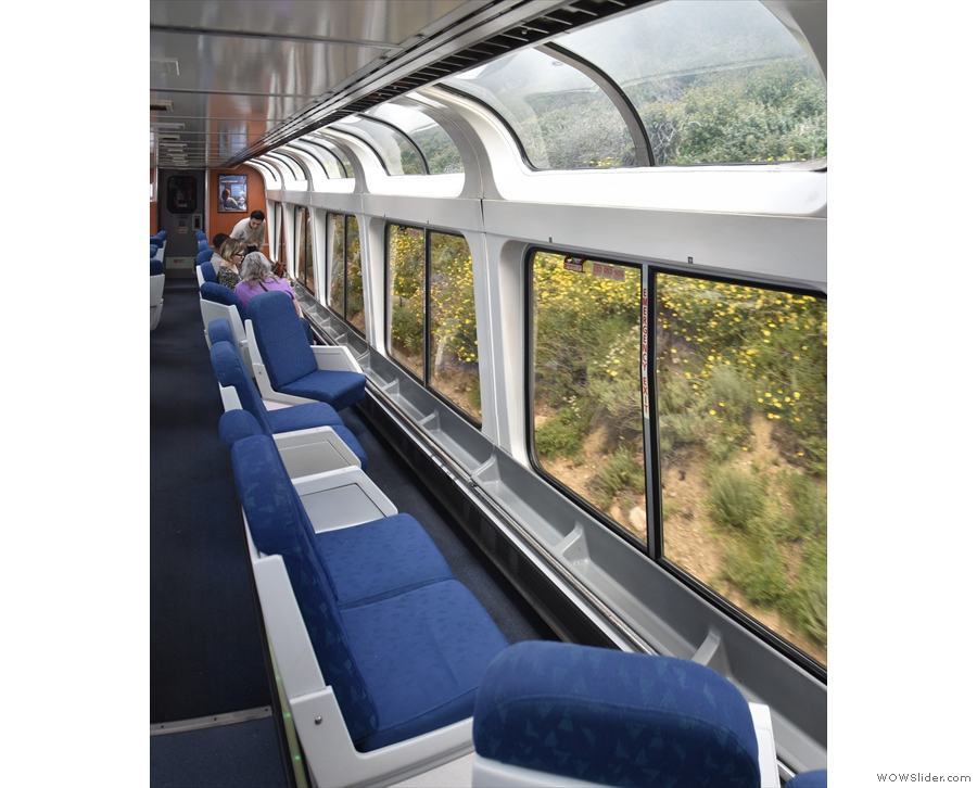 Long seats run parallel to the windows, while there are curved windows at the top.