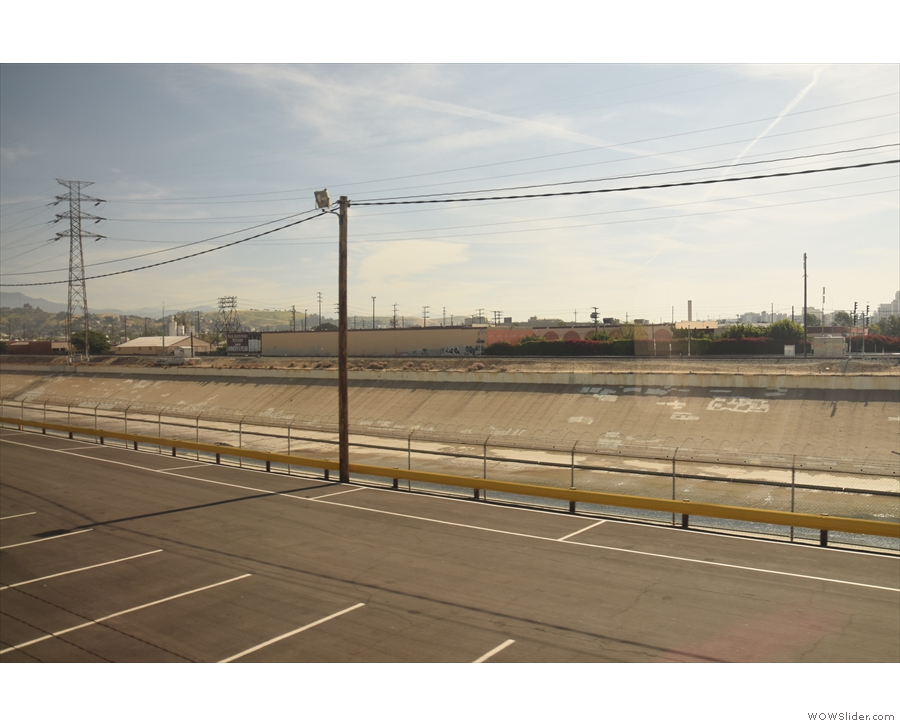 The concrete channel next to the tracks carries the Los Angeles River.
