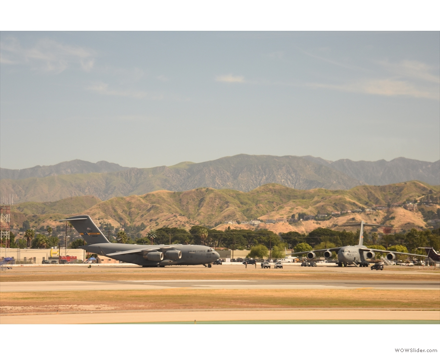 There are also some of these military cargo planes on the tarmac, although it's not...