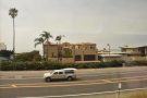 ... a linear collection of buildings between the road and the ocean.