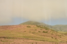 ... while all the time the patchy cloud dips down to the hill tops in the foreground.