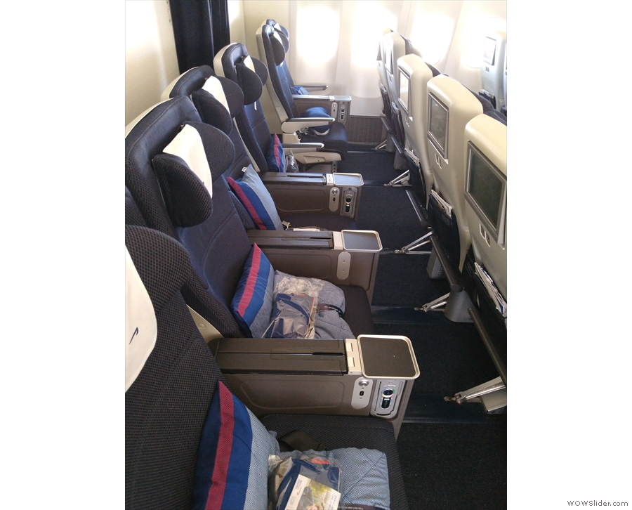 ... seen here in the back row. There are also two pairs of seats on either side...