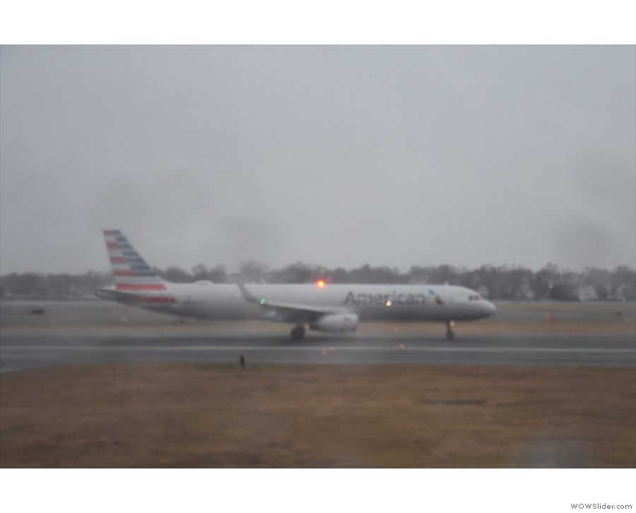 The American Airlines flight takes off...