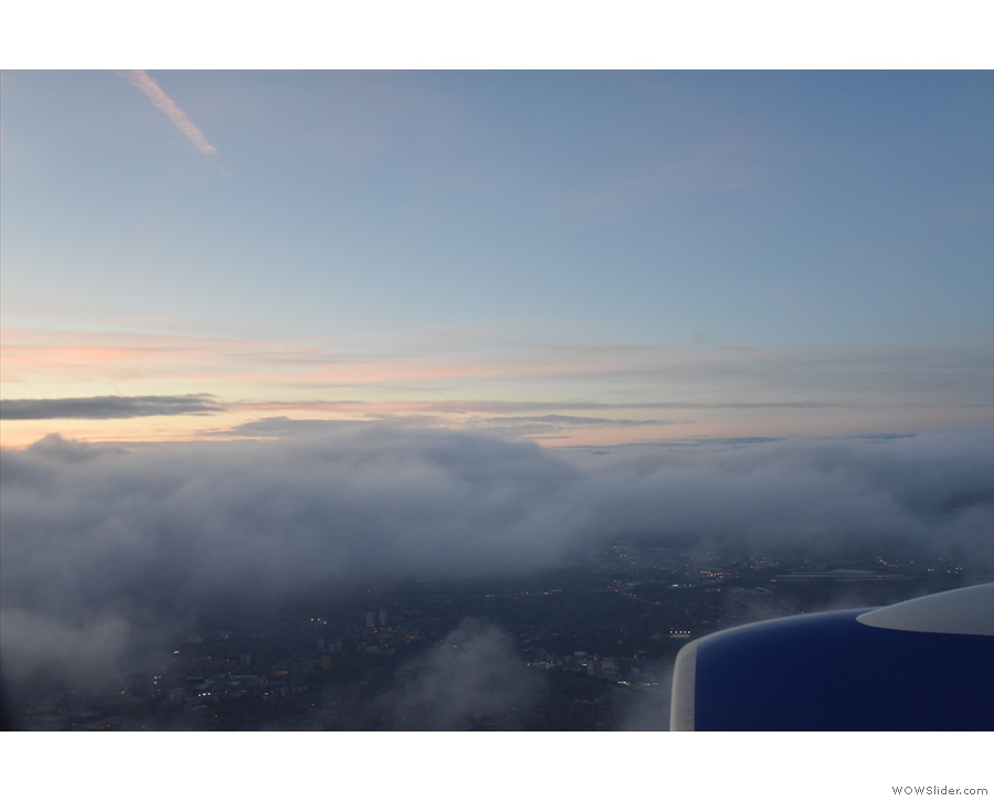 Sunset above the clouds, already night below. I'm sure that's a metaphor for something!