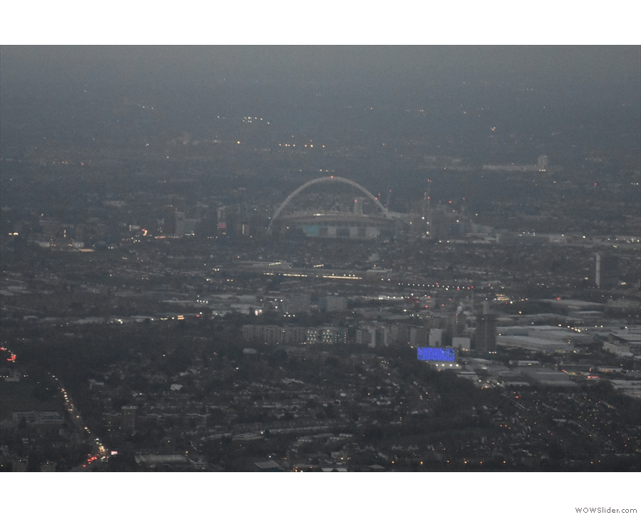 We break through the bottom of the cloud just in time for a glimpse of Wembly Arch...