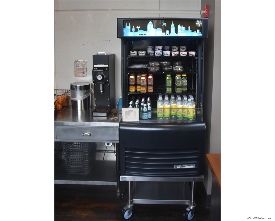 Next comes a chiller cabinet with cold drinks and a grinder (for retail bags, I think).