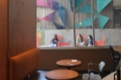 ... where this broad pillar screens the area off from the rest of the coffee bar.