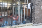 ... outdoor seating area, which is below street level at this end of the coffee bar.