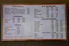 The menu, meanwhile, is on the wall behind the counter.