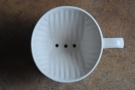The classic ridge-bottomed filter (the Melitta) has two holes. Mine, in contrast, has three.