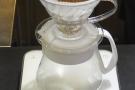 Next, put the ground coffee into the prepared filter paper. This is a pour-over which was...