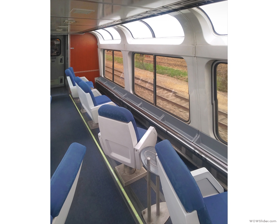 There are a range of seats facing the large windows, including single ones...