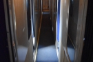 To get to the rest of the train, we had to walk down the narrow corridor to the door...