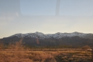 ... while the snow-capped peaks to the southwest are already in shadow.