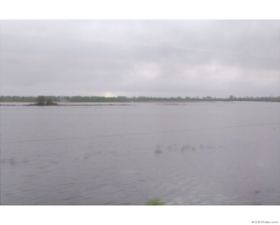 ... which is swollen with flood water, spilling out across the neighbouring fields.