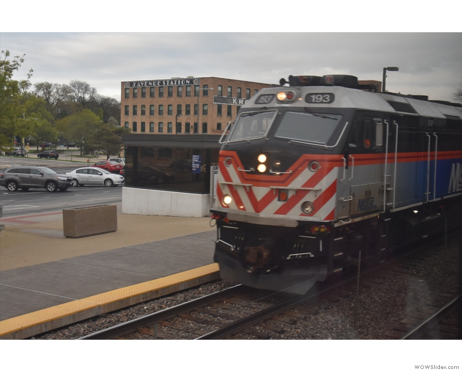 ... an outbound Metra train, which manages to stop, let off all its passengers...