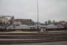 Instead we go past the end of the Amtrak yards and the Continental Paper Grading Co...