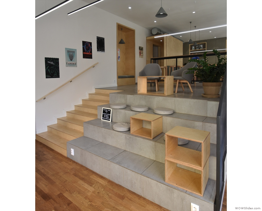 Stepping inside, you come into an entry lobby, with large, concrete steps leading up.