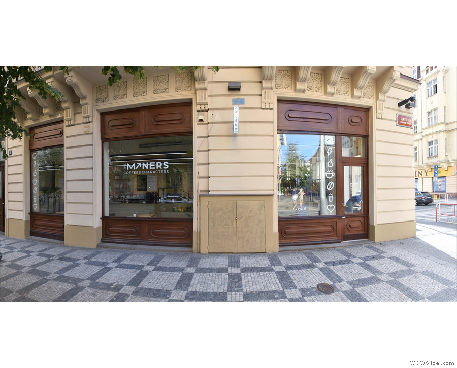 A panoramic view of the front of Minerso on Slavíkova. There are lots of windows!