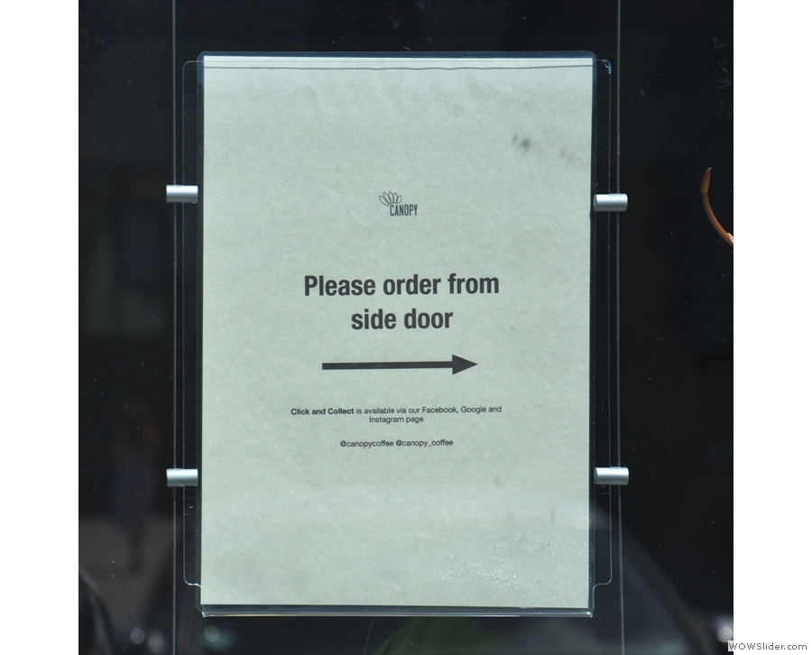 ... try to use the main door, a polite sign directs you to the side door...